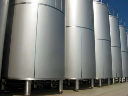 containing: huge silos containing liquid inside a factory