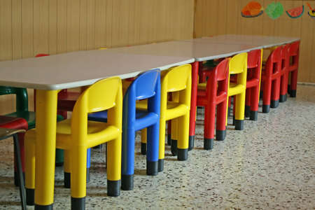 colored row of empty chairs in a dining room of a kindergarten Stock Photo - 9347283