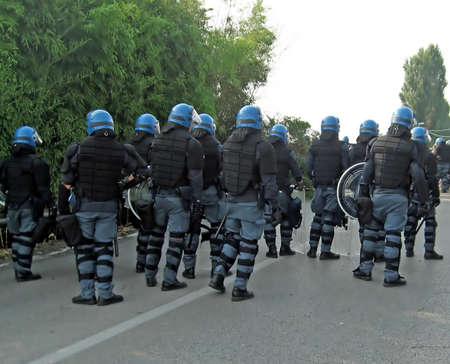 Police in riot control by the participants of an event  Stock Photo