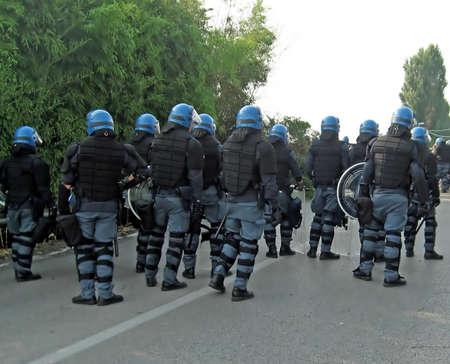 Polizei in Aufst�nden von den Teilnehmern eines Ereignisses