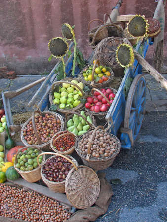 old wagon with plenty of fruits and vegetables on display at the local market  Stock Photo - 9364316