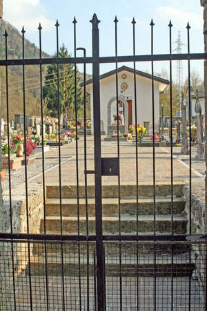 closed iron gate prevents entry to the Italian Cemetery  photo
