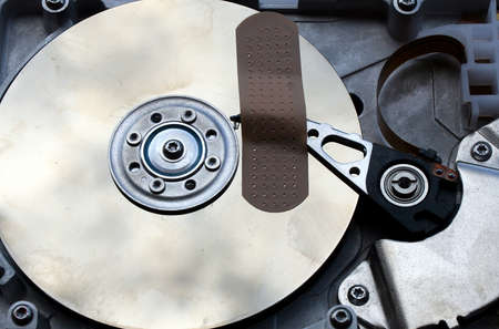 repair of a broken hard disk with a patch Stock Photo - 10842577