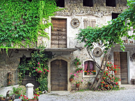 very old house in a courtyard of a mountain village Stock Photo