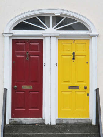 symmetrical:  two doors with bright colors at the entrance to a house in Northern Europe