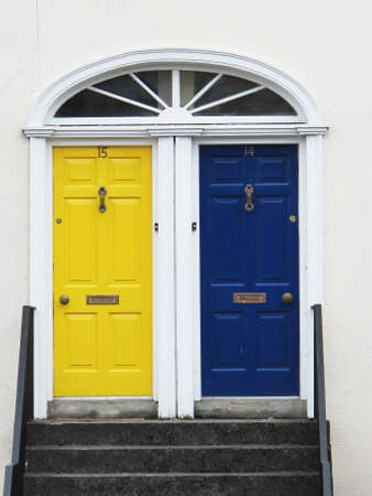 two doors with bright colors at the entrance to a house in Northern Europe