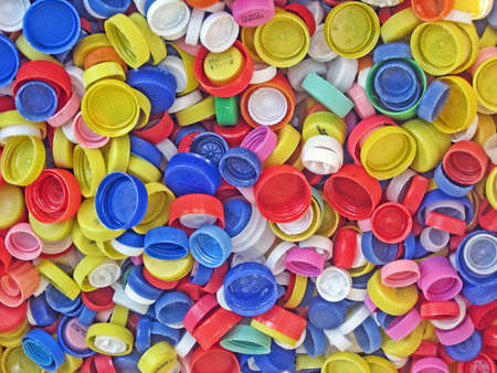 recycling of a collection of colored plastic caps for bottles photo
