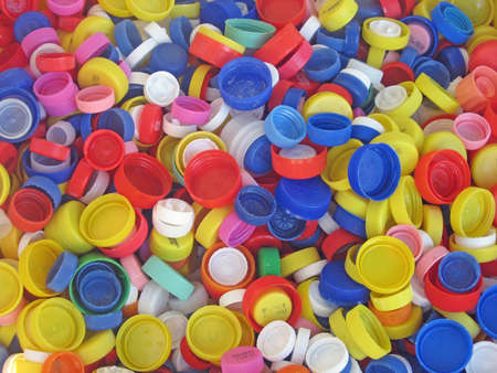 closed corks: recycling of a collection of colored plastic caps for bottles