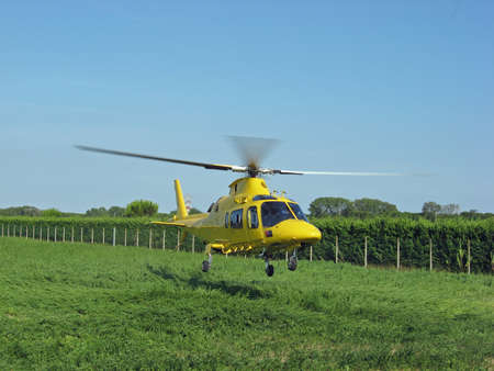yellow helicopter rescue air ambulance during an emergency take-off  photo