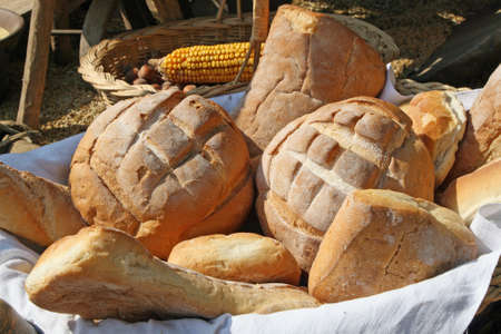 starchy food: fragrant basket of freshly baked bread for sale at the stand Stock Photo