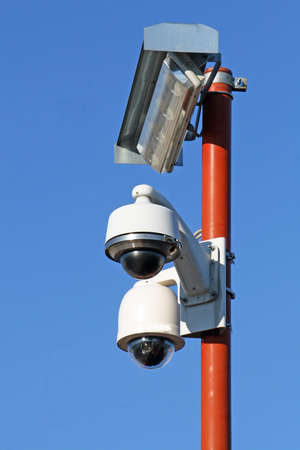 two security cameras for the safety of citizens and lamp Stock Photo - 12080840