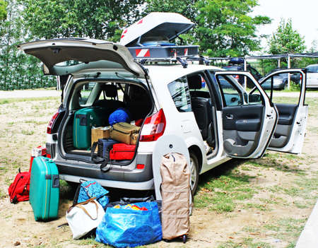 family car loaded with luggage going on holiday photo
