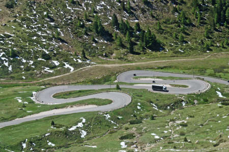 paved winding mountain road with many curves  photo