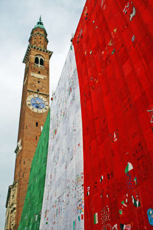 bell tower in Piazza dei Signori Vicenza  with  Italian flag on  anniversary of  unit of Italy photo
