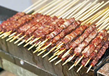 tasty kebabs of lamb and veal cooked grilled on the spit photo
