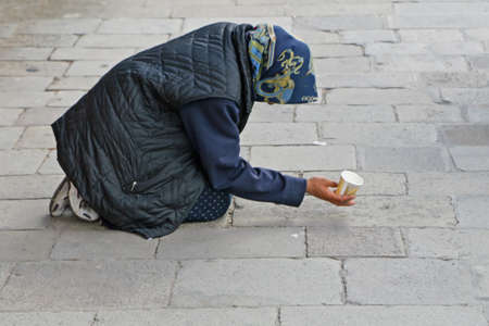 marginalized: beggar asks for alms on the street Editorial