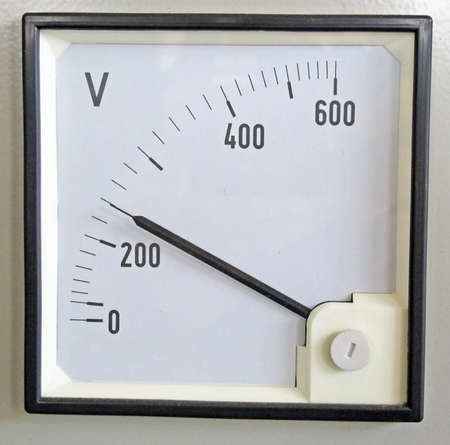 voltmeter for measuring the voltage of the electrical energy in a device photo