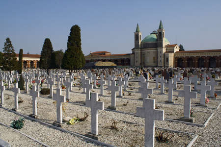 crucifixes: graves  headstones and crucifixes of a cemetery in Italy Stock Photo