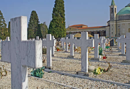 crucifixes: graves  headstones and crucifixes of a cemetery  in Italy