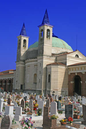 crucifixes: Church  headstones and crucifixes of a cemetery in Italy Stock Photo