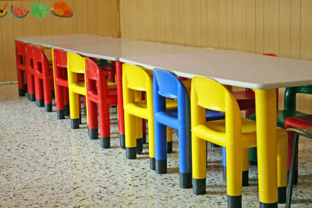 canteen: row of empty chairs in a dining room of a kindergarten Stock Photo