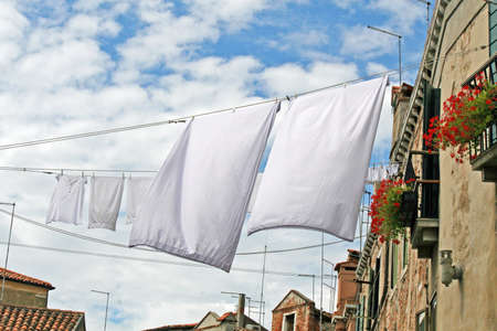 clothes hanging out to dry on a canal  photo