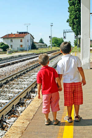 two brothers children waiting for the train station  Stock Photo - 13161507