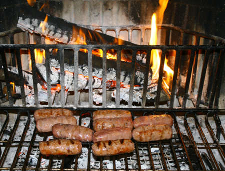suppressed: sausages cooked on the embers of the fire Stock Photo