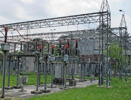 insulators and electrical cables and switches to an electric power plant outdoors Stock Photo - 13244337