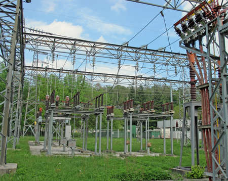 insulators and electrical cables and switches to an electric power plant outdoors Stock Photo - 13244338