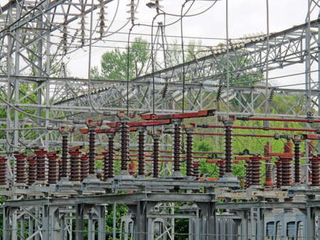 insulators: insulators and electrical cables and switches to an electric power plant outdoors Editorial