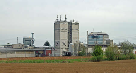 factory with high towers and a Repeater above them photo