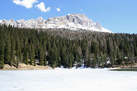 lake misurina: frozen Alpine Lake Misurina with dolomiti mountains in the background