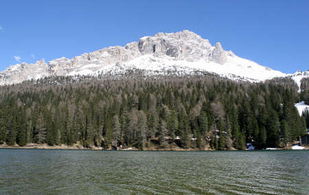 lake misurina: bright and beautiful alpine lake Misurina with dolomiti mountains in the background
