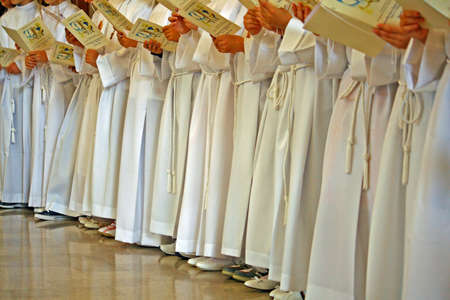 white tunics of children who make the first communion in the Church photo