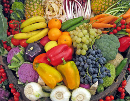 vegetable basket: basket full of grapes, peppers, cabbage, carrots, radish, pineapple