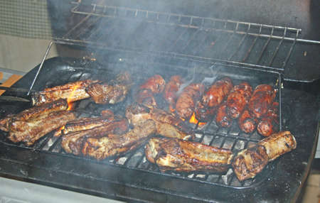 tasty grilled meat cooked over hot coals  photo