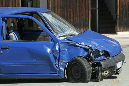 blue car destroyed in a traffic accident