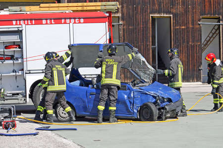 firefighters in action for free from a car, injured in a car accident