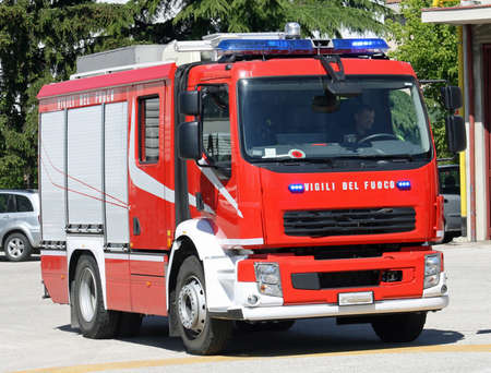 pumper: italian fire engine truck running during a mission