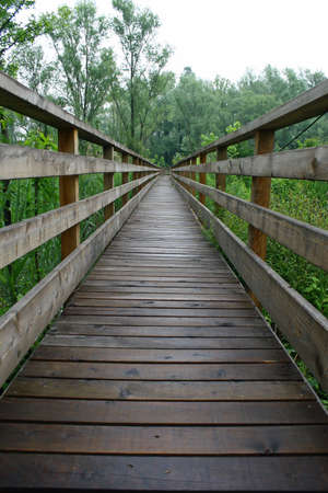 stilt house: wooden boardwalk nature trail in a nature park Stock Photo