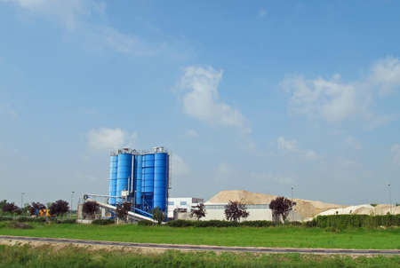 high silos to contain the cement and the sand for the building industry