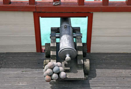 old cannon with balls in a ship of Pirates of the Caribbean photo