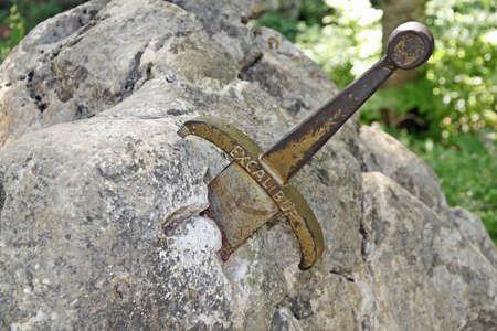 the legendary sword of King Arthur stuck in the rocks Foto de archivo
