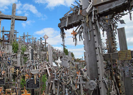 crucifixes: sad Hill of crosses with thousands of crucifixes in Lithuania Editorial
