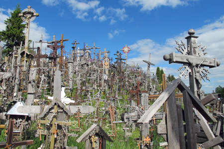 crucifixes: sad Hill of crosses with thousands of crucifixes in Lithuania Stock Photo