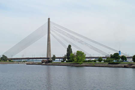sturdy steel cables support the suspension bridge over water Stock Photo