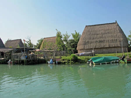 dispersed: old huts and piles of straw and wood where they dwelled fishermen Editorial