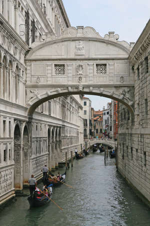 famous bridge of sighs in Venice with gondolas under