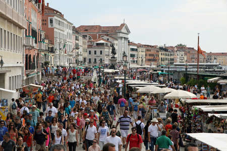 lots of people and tourists around Venice in Italy